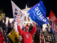 A supporter of President Trump yells at counter-protesters across the street during a rally to protest the election results outside the Georgia State Capitol on Nov. 14. President-elect Joe Biden has been declared the winner in Georgia, becoming the first Democratic nominee to win the state since 1992.