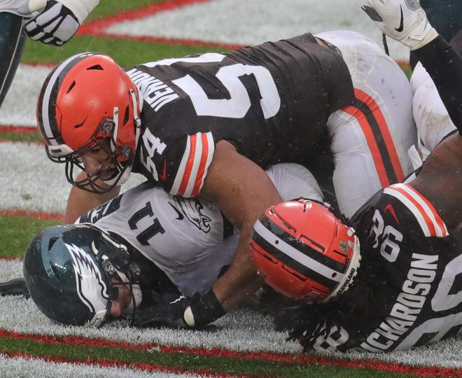 The Browns' Olivier Vernon sacks Philadelphia Eagles quarterback Carson Wentz for a third quarter safety Sunday in Cleveland.