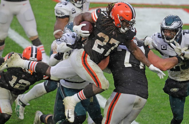 The Browns' Kareem Hunt leaps into the end zone for a fourth quarter score against the Philadelphia Eagles on Sunday in Cleveland.