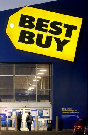 Shoppers walk into Best Buy on Thursday in Bath.