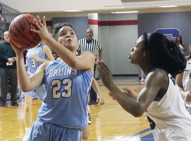 Bartlesville High's Avery Allen, left, attacks the basket during the unbeaten regular season of 2017-18.
