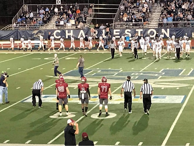 The captains prepare for the coin toss before Saturday's SCISA Class A championship game between Thomas Heyward and Lee Academy at Charleston Southern University.