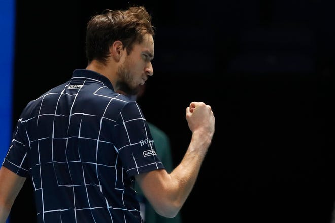 Daniil Medvedev gestures to a television camera after winning match point against Dominic Thiem in London on Sunday.