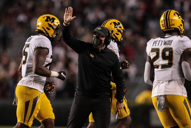 Missouri head football coach Eli Drinkwitz, center, congratulates his players during a game against South Carolina on Nov. 21 at Williams-Brice Stadium in Columbia, S.C.