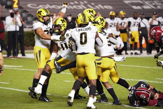 Missouri linebacker Devin Nicholson (11) celebrates a sack with Chris Turner (39), Tre Williams (0) and other teammates during a game against South Carolina on Saturday at Williams-Brice Stadium in Columbia, S.C.