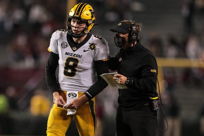 Missouri head football coach Eli Drinkwitz, right, talks with quarterback Connor Bazelak (8) during a game Nov. 21 at South Carolina.