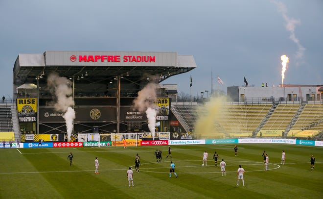 Pyrotechnics fires off after a goal by Columbus Crew SC forward Gyasi Zardes (11) during the second half of the MLS Cup playoff match against the New York Red Bulls at Mapfre Stadium in Columbus on Saturday, Nov. 21, 2020. The Crew won 3-2.