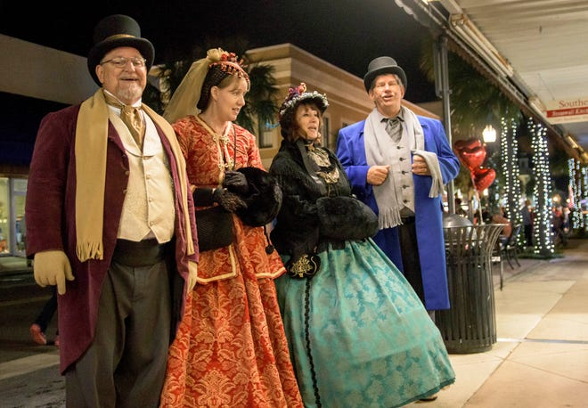Costumed performers sing carols at the Leesburg Christmas Stroll in downtown Leesburg in 2017.
