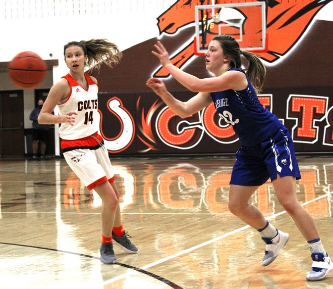 Cambridge's Ziciah Gibson (22) passes the ball during the Colts versus Bobcats girls basketball game Saturday at Meadowbrook High School.