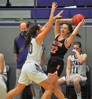 Triway's McKayla Feikert pressure's Dalton's Mia Weaver during the Titans' 50-42 win. Feikert had a big day, scoring a game-high 19 points and grabbing 10 rebounds.