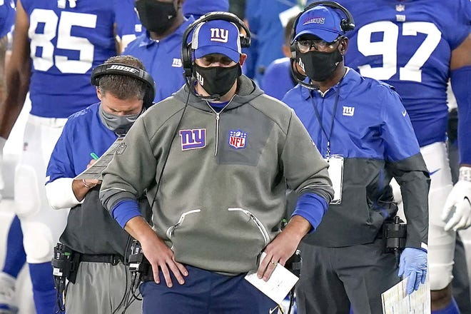Coach Joe Judge watches play from the sidelines during the fourth quarter of the New York Giants' Sept. 14 game against the Pittsburgh Steelers in East Rutherford, New Jersey.