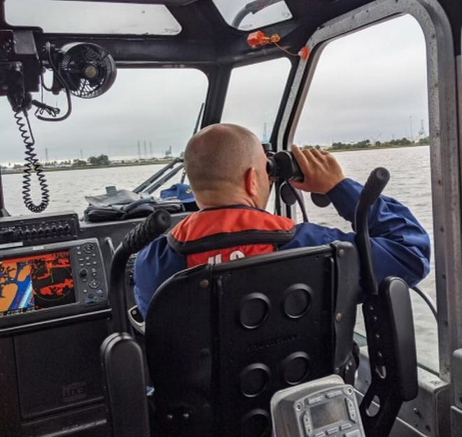 U.S. Coast Guard crews and local authorities were searching the St. Johns River near Blount Island for a man who fell overboard from a tug boat while trying to get onto a barge.