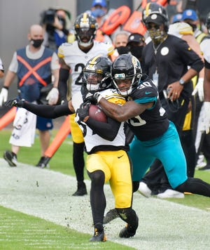 Pittsburgh Steelers free safety Minkah Fitzpatrick (39) is brought down by Jacksonville Jaguars running back James Robinson (30) after intercepting a pass Sunday, November 22, 2020 at TIAA Bank Filed in Jacksonville, Florida. (Will Dickey/Florida Times-Union)