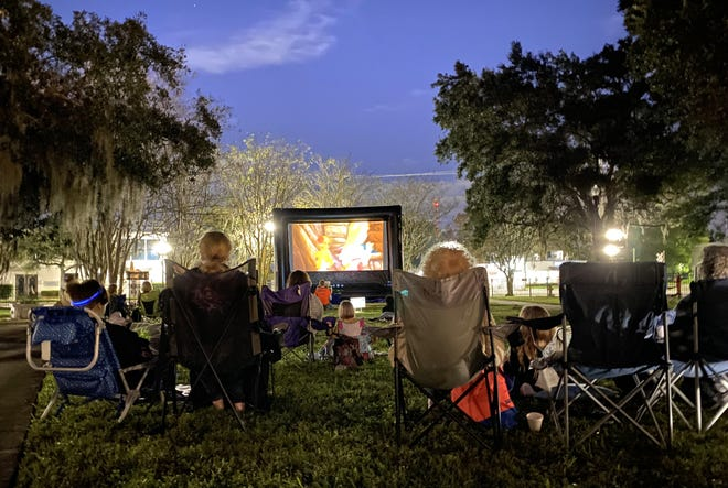 "Families enjoy a free outdoor screening of Disney's ""Enchanted"" at Fletcher Park in San Marco. The San Jose Church of Christ planned the family out for Saturday as a way to get people together, but in a safe manner, during this troubling pandemic."
