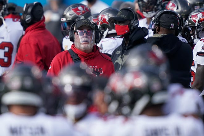 Tampa Bay Buccaneers head coach Bruce Arians walks the sidelines during the first half against the Carolina Panthers on Nov. 15 in Charlotte , N.C.
