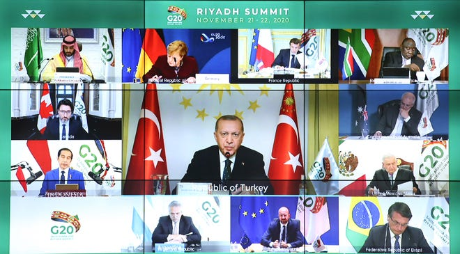 """Turkey's President Recep Tayyip Erdogan addresses the virtual G20 Leaders' Summit in Riyadh, Saudi Arabia, in a video conference from his Vahdettin Pavilion, in Istanbul, on Sunday. Erdogan said Sunday that Turkey sees itself as a part of Europe, but he called on the European Union to """"keep your promises"""" on issues such as the country's membership bid and refugees."""