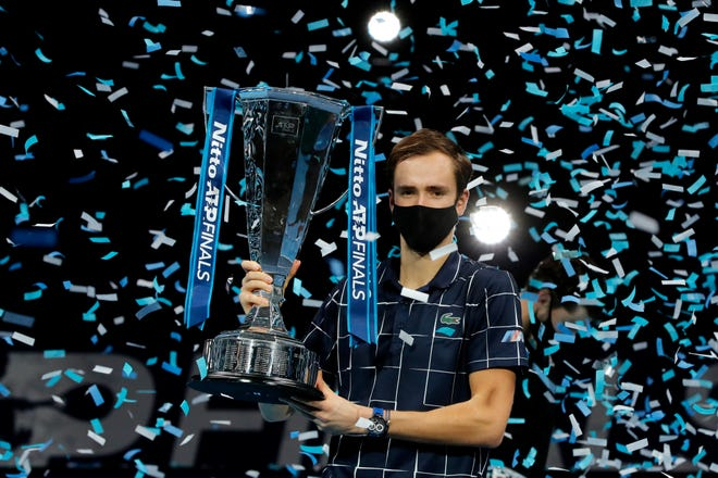 Daniil Medvedev of Russia holds up the winners trophy as confetti falls after defeating Dominic Thiem of Austria in the final of the ATP World Finals match at the ATP World Finals tournament at the O2 arena in London on Sunday.