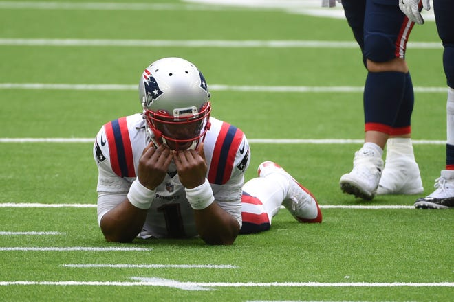 New England Patriots quarterback Cam Newton reacts after failing to complete a pass on fourth down during the second half of an NFL football game against the Houston Texans Sunday in Houston.