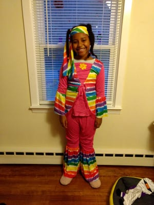 """Gianna, 9, won in the best DIY category with her""""Groovy Girl"""" costume in Millbury Public Library's virtual Halloween costume contest"""