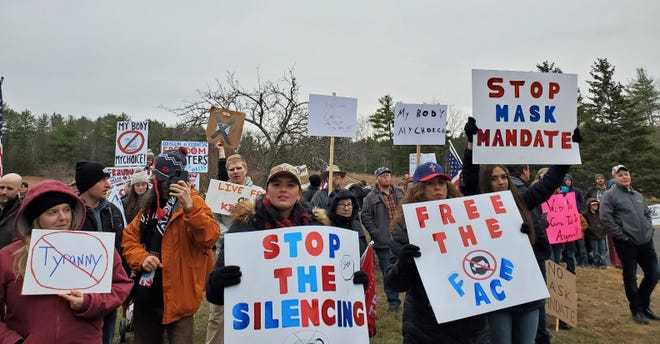 Protesters speak out against Gov. Chris Sununu's statewide mask mandate Sunday, Nov. 22, 2020 outside the governor's home in Newfields.
