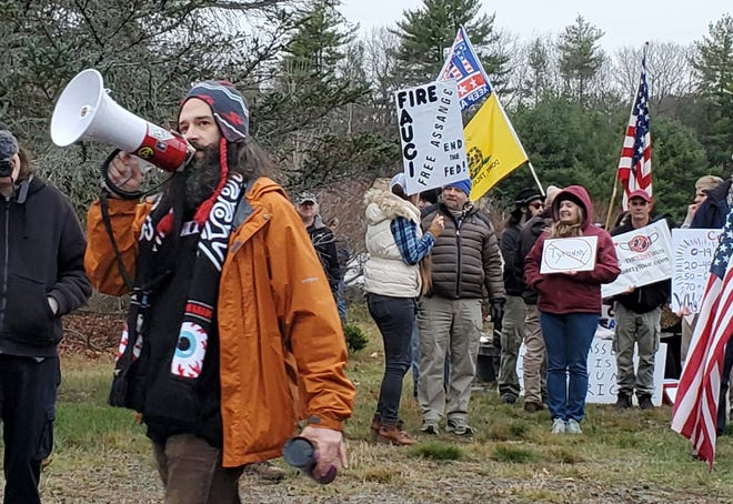 Frank Staples of Absolute Defiance leads a protest outside the home of New Hampshire Gov. Chris Sununu Sunday, Nov. 22, 2020 in Newfields.