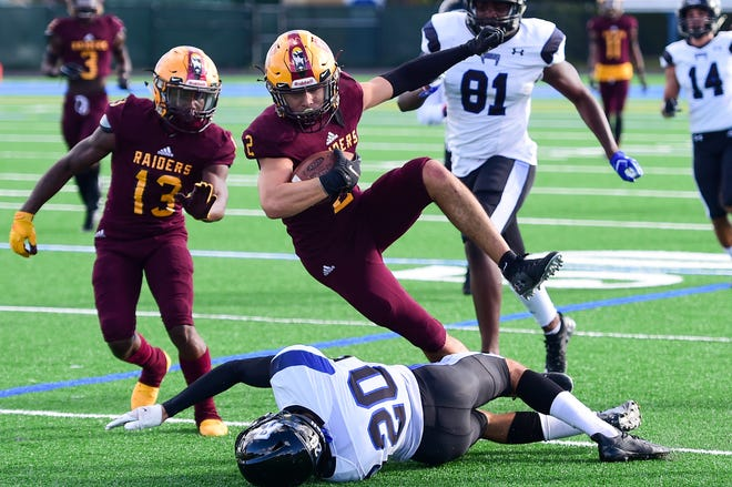 Glades Central safety Jacob Camacho returns a punt Saturday during the Raiders' 35-7 win over Park Vista.