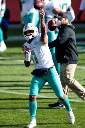 Miami Dolphins quarterback Tua Tagovailoa (1) warms up before the game against the Denver Broncos at Empower Field at Mile High on Sunday, Nov. 22, 2020 in Denver, Colorado.