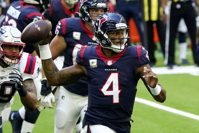Texans quarterback Deshaun Watson (4) looks to throw against the Patriots during the first half of a game earlier this season. Could the Dolphins trade for Watson this offseason?