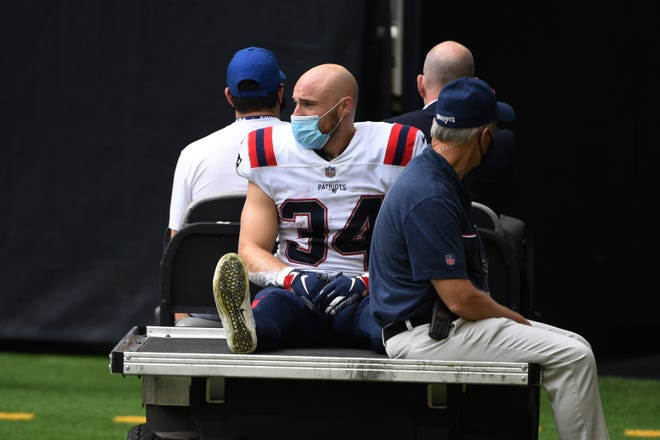 New England Patriots running back Rex Burkhead (34) is taken off the field by cart after an injury during the second half of an NFL football game against the Houston Texans, Sunday, Nov. 22, 2020, in Houston.