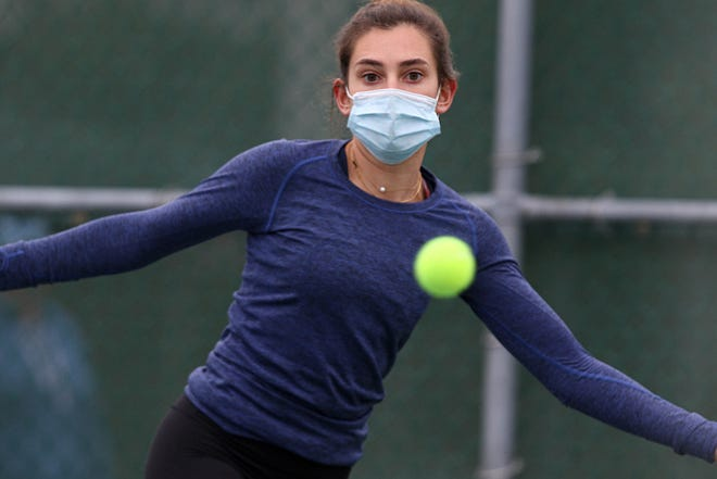 Moses Brown's Candice Ballarin wins Sunday's singles championship by beating East Greenwich's Maddie Omicioli, 6-0, 6-2, at Slater Park.