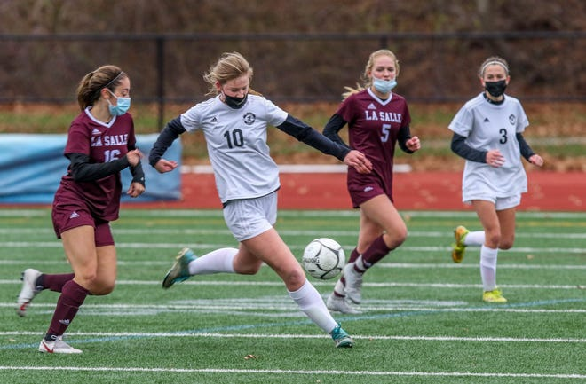 Pilgrim's Lily Brown leads the rush up the field during Sunday's Division I championship game against La Salle.  Even though the Patriots lost, 3-0, it had a different feel from other title disappointments.