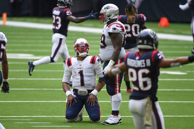 New England Patriots quarterback Cam Newton (1) reacts after failing to complete a pass on fourth down during the second half of an NFL football game against the Houston Texans on Sunday in Houston.