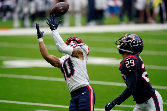 New England Patriots wide receiver Damiere Byrd (10) catches a pass for a touchdown past Houston Texans cornerback Phillip Gaines (29) during the second half of an NFL football game, Sunday, Nov. 22, 2020, in Houston. (AP Photo/David J. Phillip) ORG XMIT: TXEG127