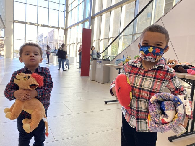 Linkon Edwards, 2, and his brother Marquis Edwards, 4, hold their plush toys and blankets in the San Joaquin Superior Courthouse lobby Saturday after being adopted by their grandmother, Tina Tiffany, during the 21st annual National Adoption Day event.