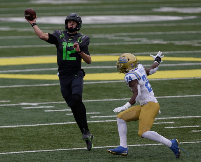 Oregon quarterback Tyler Shough (12) had a career-high 334 passing yards against Qwuantrezz Knight and the UCLA Bruins during last week's 38-35 win at Autzen Stadium.