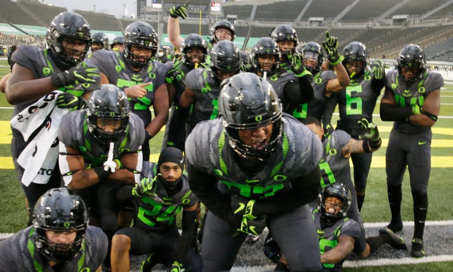 Oregon football players celebrate their victory over UCLA in an NCAA college football game Saturday, Nov. 21, 2020, in Eugene, Ore.