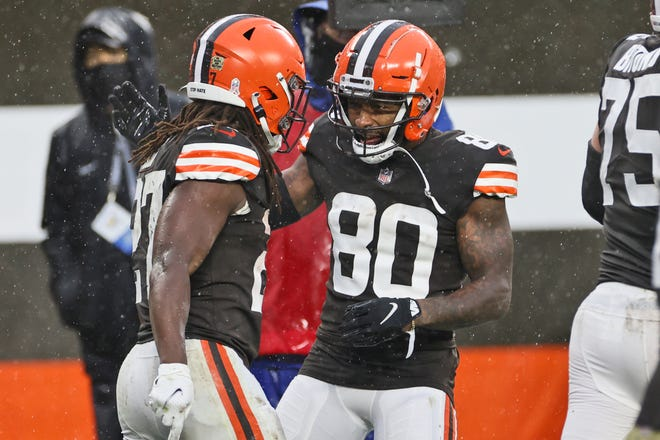 Browns wide receiver Jarvis Landry (80) celebrates with running back Kareem Hunt (27) after Hunt scored during the second half of the Browns' game against the Philadelphia Eagles Nov. 22 in Cleveland. (AP Photo/Ron Schwane)