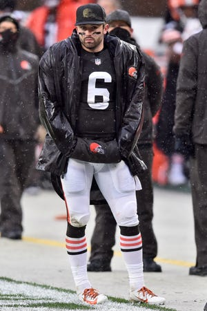 Cleveland Browns quarterback Baker Mayfield (6) watches from the sidelines during the first half of an NFL football game against the Philadelphia Eagles, Sunday, Nov. 22, 2020, in Cleveland. (AP Photo/David Richard)