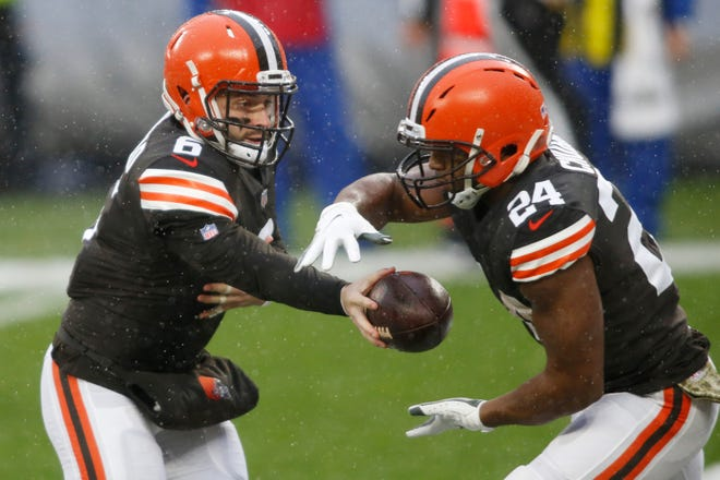 Cleveland Browns quarterback Baker Mayfield (6) hands off to running back Nick Chubb (24) against the Philadelphia Eagles on Nov. 22. The Browns have the top rushing offense in the NFL with an average of 161.4 yards per game. (Scott Galvin-USA TODAY Sports)