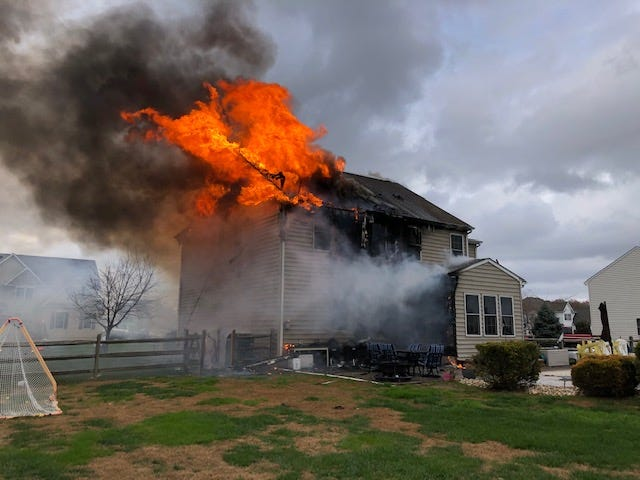 Fire ravages a home in the Jockey Hollow neighborhood near Clayton this afternoon, Nov. 22.