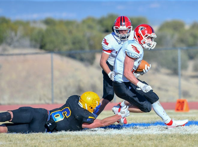 Centauri High School running back Mason Claunch, right, escapes a tackle from Florence's Owen Busetti during the second quarter of their Class 1A quarterfinal matchup on Saturday at Florence High School. [Chieftain photo/Austin White