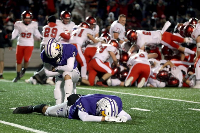 DeSales' J.J. Baughman (25) and Nicky Pentello (2) drop to the turf after Baughman's missed field goal in double overtime secured a 31-28 victory for Chardon in the Division III state championship game Nov. 21 at Paul Brown Tiger Stadium in Massillon.