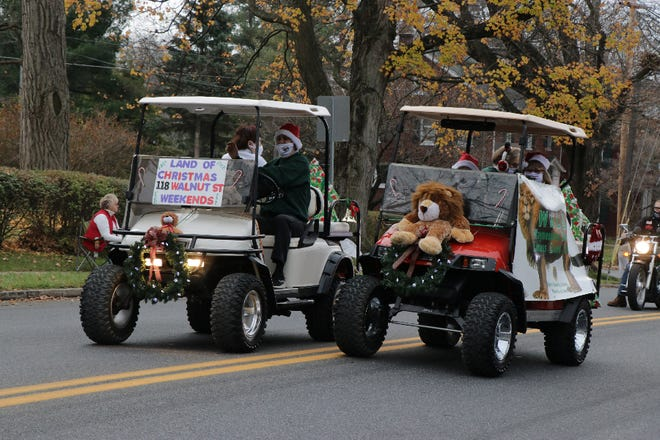 The WALL Club's entry in the Waynesboro Christmas Parade promoted its Land O' Christmas, a free, family-friendly display of Christmas trees and holiday decorations, being held weekends at the Boro Plaza on Walnut Street.