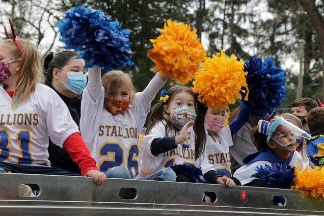 Masked Waynesboro Stallions cheerleaders were among the participants in the Waynesboro Christmas Parade on Saturday.