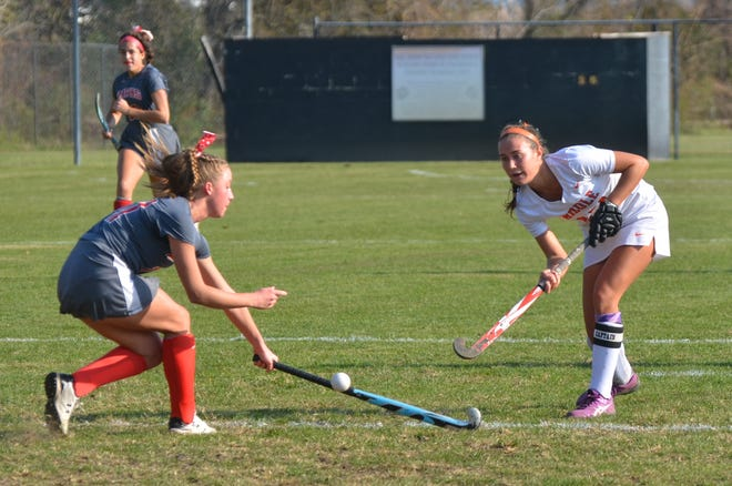 Middle Township senior Kate Herlihy lifts a pass over the stick of Haddon Township's Lilli Santamauro.