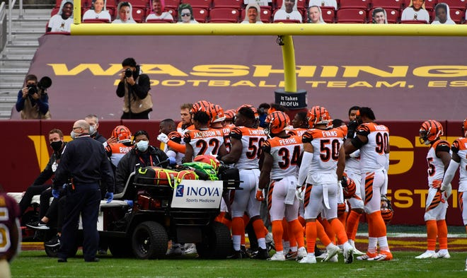 Nov 22, 2020; Landover, Maryland, USA; Cincinnati Bengals players console quarterback Joe Burrow (9) after suffering an apparent knee injury during the second half against the Washington Football Team at FedExField.