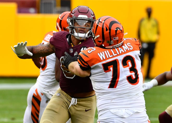 Nov 22, 2020; Landover, Maryland, USA; Cincinnati Bengals offensive tackle Jonah Williams (73) blocks Washington Football Team defensive end Chase Young (99) during the second half at FedExField.