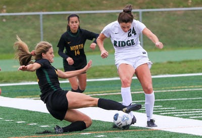 North Hunterdon's Arden MacNeil (left) slide tackles Ridge's Olivia Pikiell during their NJSIAA Central West C final on Sunday, Nov. 22, 2020.