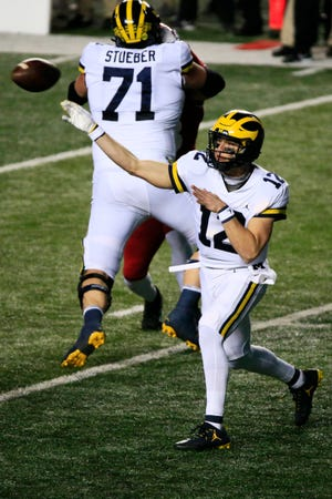 Cade McNamara (12) of the Michigan Wolverines throws during the second quarter at SHI Stadium on November 21, 2020 in Piscataway, New Jersey.