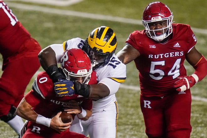 Michigan's Christopher Hinton (15) gets past Rutgers offensive lineman Cedrice Paillant (54) to sack quarterback Noah Vedral (0) during the first half on Saturday in Piscataway, N.J.